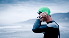 Triathlete making final adjustments to his triathlon wetsuit